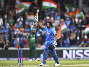 India's Rohit Sharma celebrates his century during the Cricket World Cup match between India and Pakistan at Old Trafford in Manchester, England, Sunday, June 16, 2019. (AP Photo/Dave Thompson)