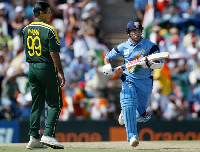 Indian batsman Sachin Tendulkar runs down the wicket while Pakistan's captain Waqar Younis looks on in India's defeat of Pakistan in their 2003 ICC World Cup match. AFP