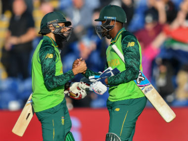South Africa's Hashim Amla (L) celebrates with teammate South Africa's Andile Phehlukwayo after victory in the 2019 Cricket World Cup. AFP
