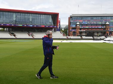 Chief Executive Officer of the International Cricket Council (ICC) David Richardson walks on the field at Old Trafford Cricket Stadium in Manchester on June 14, 2019, after a pitch inspection ahead of the 2019 World Cup match between Pakistan and India. (Photo by Dibyangshu SARKAR / AFP)