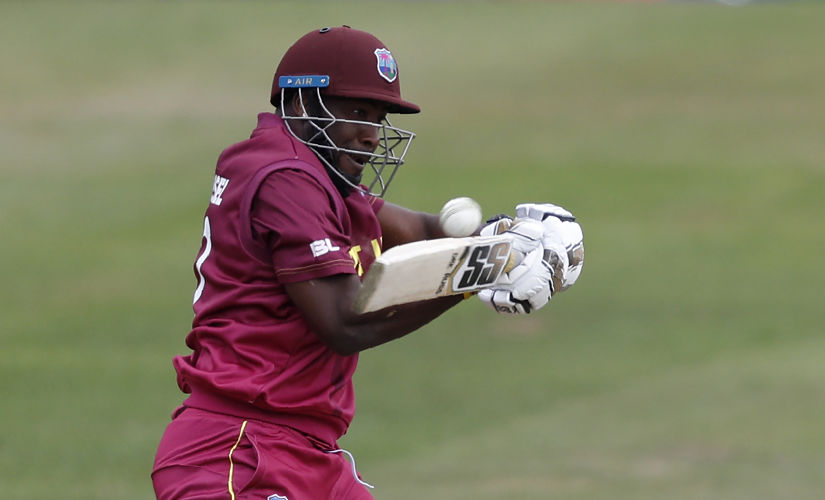West Indies' Andre Russell bats during the 2019 Cricket World Cup warm up match between the West Indies and New Zealand at Bristol County Ground in Bristol, southwest England, on May 28, 2019. (Photo by Adrian DENNIS / AFP)