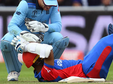 Afghanistan's Hashmatullah Shahidi was brought down by a blow to the helmet in the loss to England. (AFP)