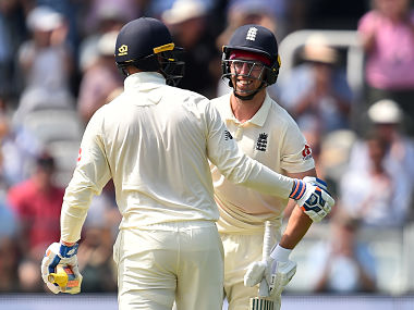 England's Jack Leach (R) celebrates his half century with teammates on the second day of the first cricket Test match between England and Ireland at Lord's cricket ground in London on July 25, 2019. (Photo by Glyn KIRK / AFP) / RESTRICTED TO EDITORIAL USE. NO ASSOCIATION WITH DIRECT COMPETITOR OF SPONSOR, PARTNER, OR SUPPLIER OF THE ECB