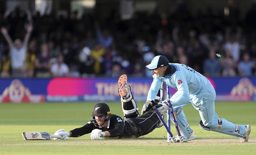 England's Jos Buttler runs out New Zealand's Martin Guptill during the Super Over in the Cricket World Cup final. AP