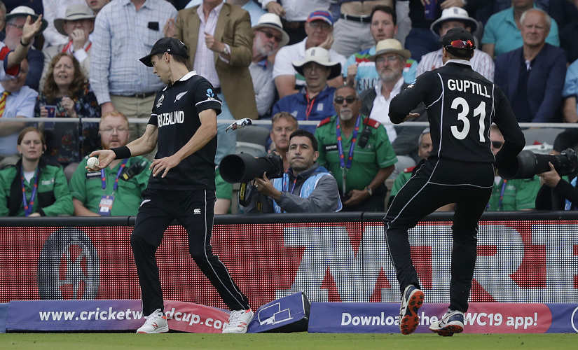 New Zealand's Trent Boult catches England's Ben Stokes but steps on the boundary rope to concede six runs. AP
