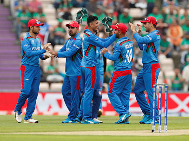 Cricket - ICC Cricket World Cup - Bangladesh v Afghanistan - The Ageas Bowl, Southampton, Britain - June 24, 2019 Afghanistan's Mujeeb Ur Rahman celebrates with team mates after taking the wicket of Bangladesh's Liton Das Action Images via Reuters/John Sibley - RC1C92435A00