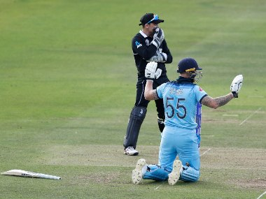 Ben Stokes holds up his hands apologetically after a throw ran down to ropes after getting deflected off his bat in World Cup final. AP