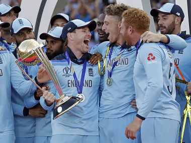 Eoin Morgan holds the trophy as he celebrates with Jos Buttler, center, and Jonny Bairstow after lifting the World Cup. AP
