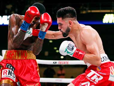 WBC champion Jose Ramirez defeats WBO title holder Maurice Hooker in world super lightweight unification bout