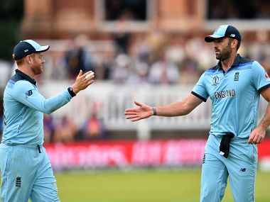 England's Jonny Bairstow (L) congratulates England's Liam England's Liam Plunkett after he finished his bowling over during the 2019 Cricket World Cup final between England and New Zealand at Lord's Cricket Ground in London on July 14, 2019. (Photo by Glyn KIRK / AFP) / RESTRICTED TO EDITORIAL USE