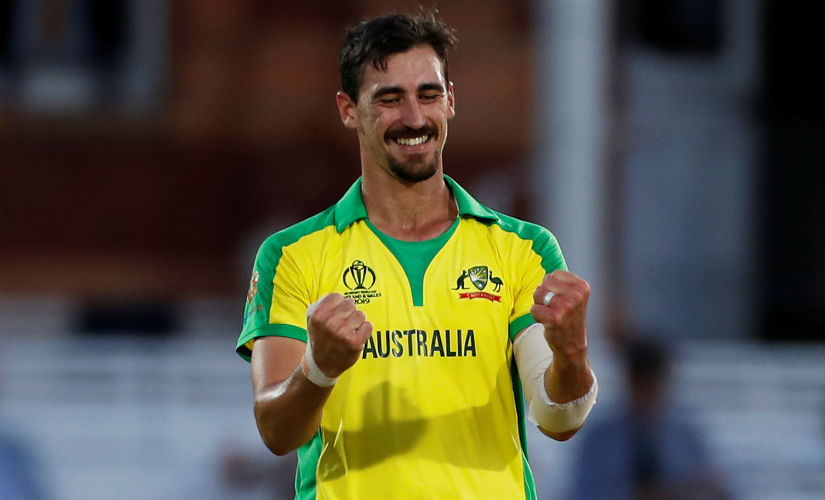 Australia's Mitchell Starc celebrates after picking up a wicket. AFP