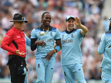 File picture of Jofra Archer (L) and Chris Woakes. AFP