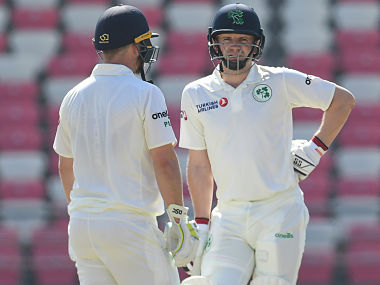 Ireland's Paul Stirling (L) and William Porterfield stand during the day one of the test match between Afghanistan and Ireland at the Rajiv Gandhi international cricket stadium in the northern Indian city of Dehradun on March 15, 2019. (Photo by Money SHARMA / AFP) / ----IMAGE RESTRICTED TO EDITORIAL USE - STRICTLY NO COMMERCIAL USE----- / GETTYOUT