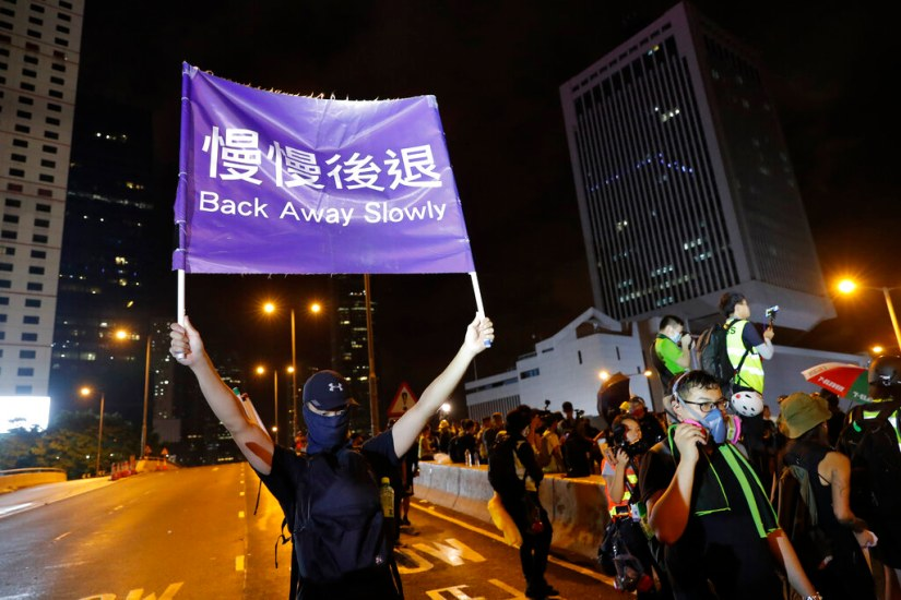 Hong Kong sees largest rally in weeks as protesters flood streets braving torrential rains despite warnings from Beijing