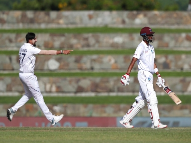 Roston Chase (R) walks back for 48 after being dismissed by Ishant Sharma. AP