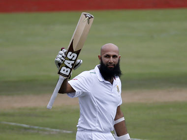 South Africa's Hashim Amla raises his bat as he celebrates his hundred century during the fourth cricket test match against England at Centurion, South Africa, January 22, 2016. REUTERS/Siphiwe Sibeko - D1AESIQHOXAB