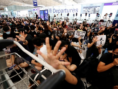 Day after shutting down Hong Kong airport authorities suspend checkin for all flights leaders warn of dangerous consequences