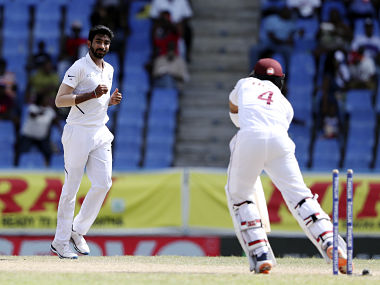 India's Jasprit Bumrah looks at West Indies' Shai Hope after dismissing him during day four of the first Test cricket match at the Sir Vivian Richards cricket ground in North Sound, Antigua and Barbuda, Sunday, Aug. 25, 2019. (AP Photo/Ricardo Mazalan)