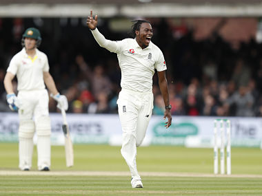 England's Jofra Archer celebrates after taking the wicket of Australia's Usman Khawaja caught behind during play on day five of the 2nd Ashes Test cricket match between England and Australia at Lord's cricket ground in London, Sunday, Aug. 18, 2019. (AP Photo/Alastair Grant)