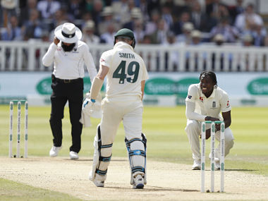 England's Jofra Archer looks up at Australia's Steve Smith during play on day four of the 2nd Ashes Test cricket match between England and Australia at Lord's cricket ground in London, Saturday, Aug. 17, 2019. (AP Photo/Alastair Grant)