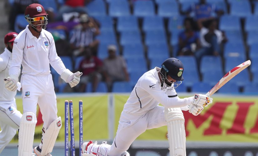 KL Rahul was bowled while attempting to paddle Roston Chase's delivery around the corner. AP