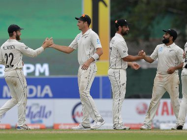 New Zealand players congratulate each others as they celebrate their win over Sri Lanka by an innings and a sixty five runs on day five of the second Test. AP