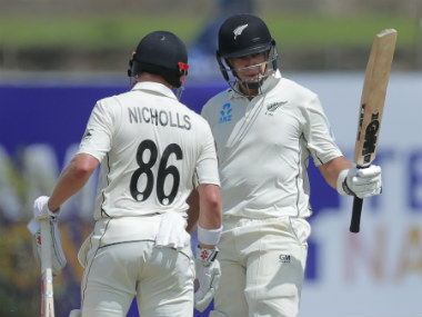 Ross Taylor raises his bat after completing his 31st career fifty on the opening day of the Galle Test. AP