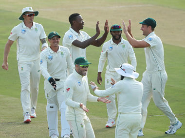 Cricket - South Africa v Pakistan - Second Test - PPC Newlands, Cape Town, South Africa - January 5, 2019 South Africa's Kagiso Rabada celebrates with team mates after taking the wicket of Pakistan's Babar Azam (not pictured) REUTERS/Mike Hutchings - RC176925FF30