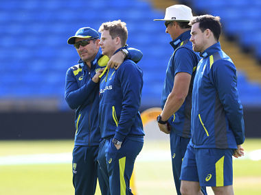 Australia coach Justin Langer, left, and Steve Smith, second left, during a nets session at Headingley, Leeds, England, Tuesday Aug. 20, 2019. England and Australia will begin the 3rd Ashes Test cricket match on Aug. 22. (Mike Egerton/PA via AP)