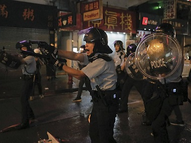 Hong Kong prodemocracy protests escalate as demonstrators attack police with sticks rods 36 including 12yearold arrested