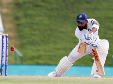 Virat Kohli plays a shot en route his fifty on the third day of the first Test against the West Indies. AP