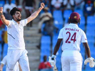 Ishant Sharma (L) of India celebrates the dismissal of Kemar Roach (R) of West Indies during day 2 of the 1st Test between West Indies and India at Vivian Richards Cricket Stadium in North Sound, Antigua and Barbuda, on August 23, 2019. (Photo by Randy Brooks / AFP)
