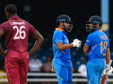 Shreyas Iyer (C) and Virat Kohli (R) of India celebrate 50 partnership as Carlos Brathwaite (L) of West Indies expresses disappointment during the 3rd ODI match between West Indies and India at Queens Park Oval, Port of Spain, Trinidad and Tobago, on August 14, 2019. (Photo by Randy Brooks / AFP)