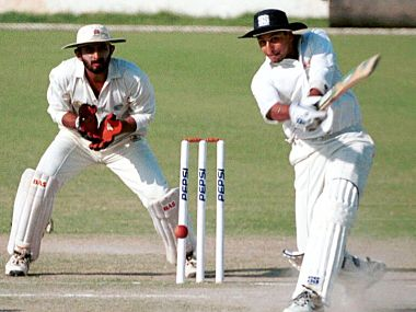 Rajasthan batsman Saket Bhatia(53 runs) drives a ball to boundary while Punjab wicketkeeper and captain Vikram Rathour looks on, on the third day of the pre-quarter final Ranji trophy match between Punjab and Rajasthan at PCA stadium, Mohali 12 March 2001. Punjab won the match by an innings and 12 runs and advances to the quarter finals. SPORTASIA PHOTO / SWATI (Photo by SWATI / SPORTASIA / AFP)