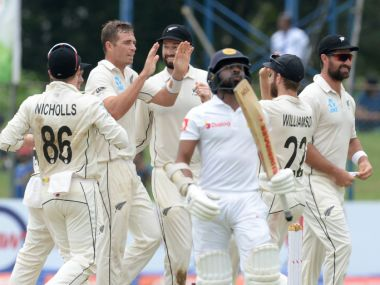 New Zealand cricketer Tim Southee (2L) celebrates with his teammates after he dismissed Sri Lankan cricketer Niroshan Dickwella (C) during the second day of the final cricket Test match between Sri Lanka and New Zealand at P. Sara Oval cricket stadium in Colombo on August 23, 2019. (Photo by LAKRUWAN WANNIARACHCHI / AFP)