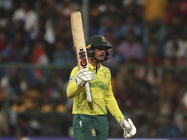 South Africa captain Quinton de Kock raises his bat to celebrate after scoring fifty against India in third T20I. AP