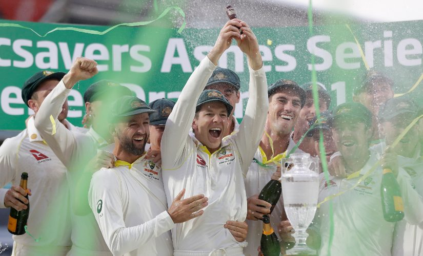 Australian captain Tim Paine lifts the coveted Urn after his side retained Ashes in England. AP