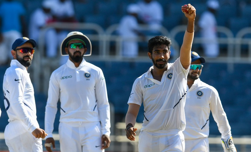 Bumrah points the ball towards the dressing room after claiming second five-wicket haul of the ongoing series. AFP