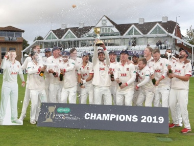 Essex's squad along with a cut out of Peter Siddle, extreme left, lift the trophy after winning England's county championship. Image courtesy: Twitter @EssexCricket