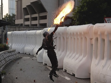 Hong Kong protests Police fires water cannons tear gas after protesters hurl petrol bombs at govt buildings in Admiralty district