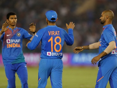 Navdeep Saini (L) celebrates a wicket with Virat Kohli (C) and Shikhar Dhawan during the second T20I against South Africa. AP