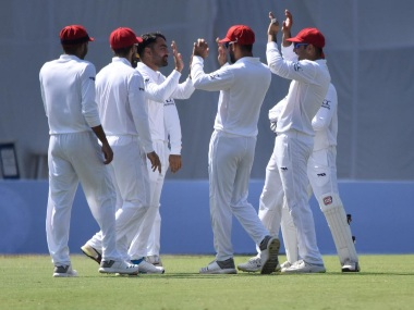 Rashid Khan celebrates a fall of a wicket with Afghanistan teammates on Day 2. Image courtesy: Twitter @ICC