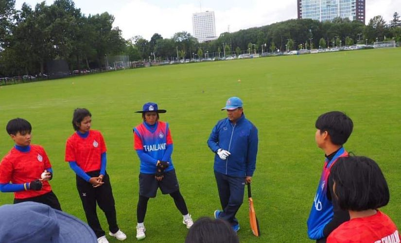 Thailand coach Harshal Pathak giving instructions to the players.