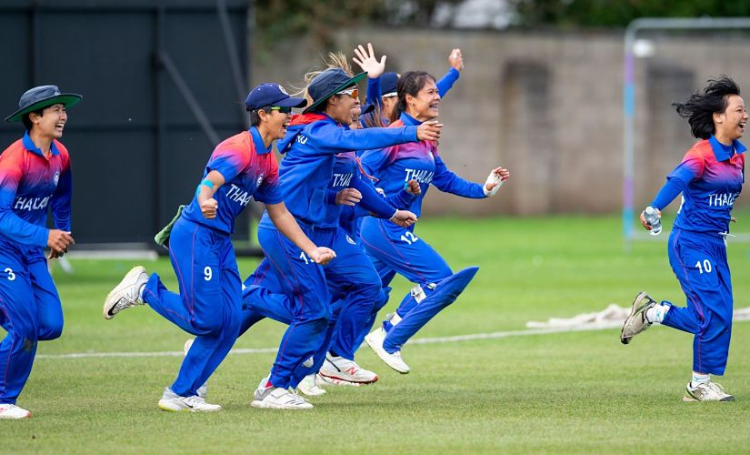 Thailand players storm into the ground as Nattaya Boochatham scores the winning run against Papua New Guinea. ICC