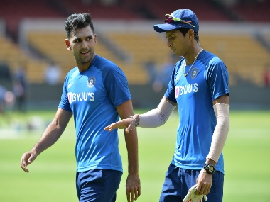 Deepak Chahar (L) and Navdeep Saini interact during a practice session at the M. Chinnaswamy Stadium in Bangalore. AFP