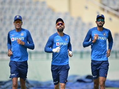 Virat Kohli (C), Rahul Chahar (L) and Khaleel Ahmed run during a practice session. AFP