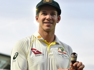 Tim Paine poses with the Ashes Urn. AFP