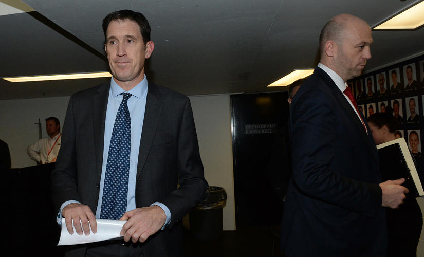 """Cricket Australia CEO James Sutherland (L) and Australian Cricketers' Association CEO Alistair Nicholson leave after a press conference in Melbourne on August 3, 2017. - Australia's bruising and protracted cricket pay dispute was finally resolved on August 3 with players and management agreeing on a new """"in-principle"""" deal, ensuring upcoming series against Bangladesh, India and England can go ahead. (Photo by Mal Fairclough / AFP)"""