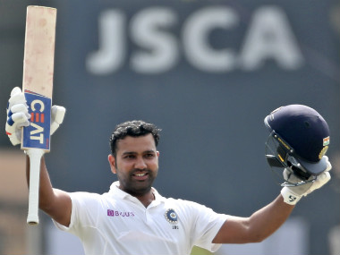 India's Rohit Sharma celebrates after scoring a double century during the second day of third and final Test match between India and South Africa. AP