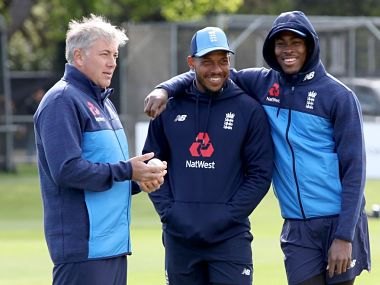 England's new player Jofra Archer (R) poses with Chris Jordan (C) and bowling coach Chris Silverwood before a one day international between Ireland and England Malahide cricket club, in Dublin on May 3, 2019. (Photo by Paul Faith / AFP)